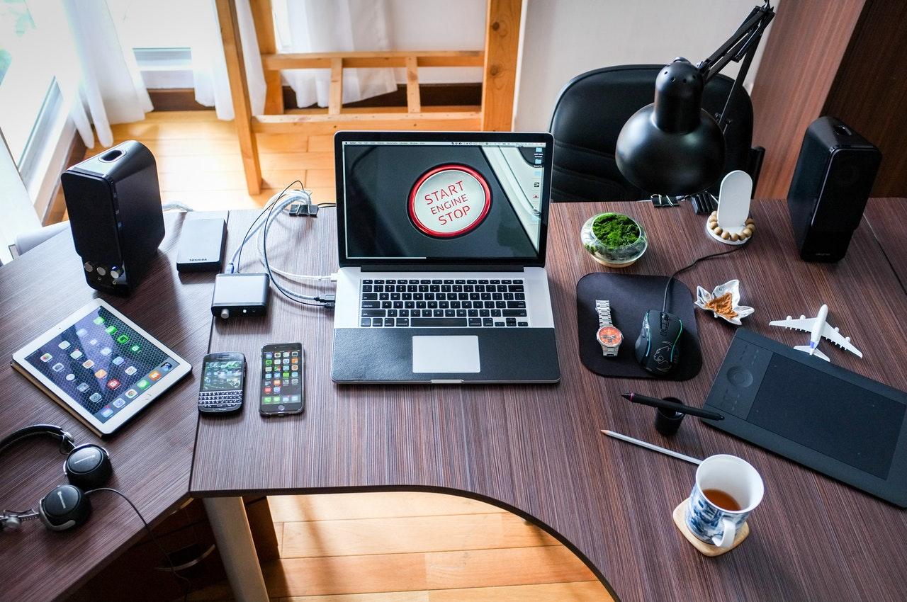 Corner computer desk setup with laptop