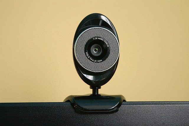 A webcam setup on top of a computer monitor.
